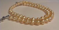 persikofärgade pärlor