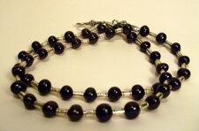Halsband med svarta pärlor